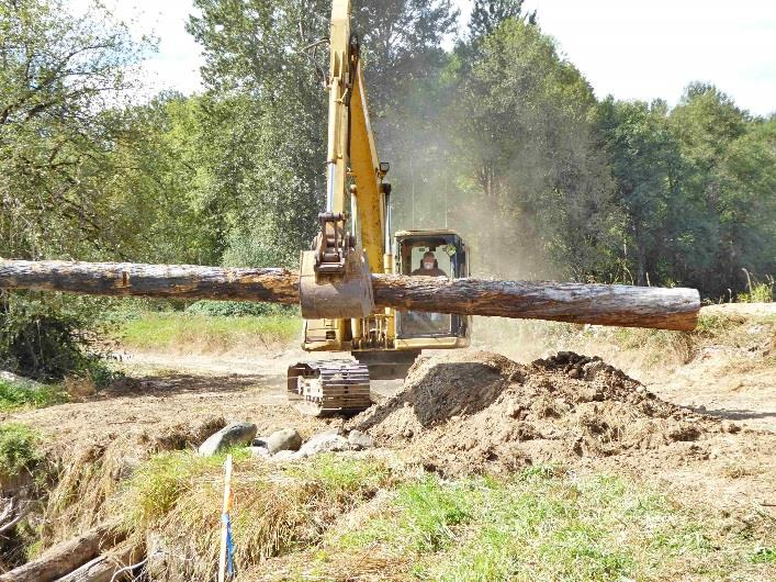 Logs Being Placed in Stream Bank Slots
